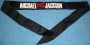 """""""Michael BAD Jackson"""" Head Band; 43 1/2""""x1 1/2"""" black head band with """"M.J."""" written in white with red """"BAD"""" logo written red in the middle"""