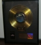 In The Closet RIIA Gold Award To L.Flick For The Sale Of 500,000 Copies Sold Of The Single/CD/Tape In USA