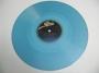 """Mueve Tu Cuerpo (Bajo La Tierra) Limited Edition 12"""" Single Blue Vinyl (Colombia)"""