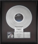Thriller RIAA Platinum Award For The Sale Of 1,000,000 Copies Of The Album, Cassette And CD In USA